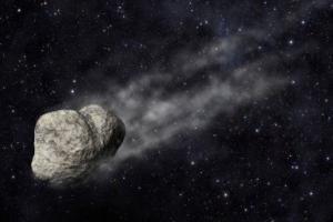К Земле приближается огромный астероид. На картинке астероид на фоне Земли