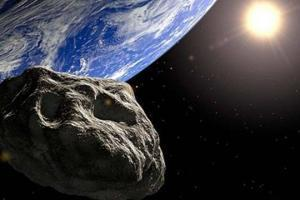 К Земле летит огромный астероид: чего ждать? На картинке оба небесных тела